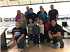 Children and adult participants at Bowling with Heros