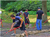 People build a walkway at Hasson park