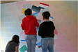 People paint a mural for community service