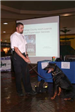 An officer and canine participate in Juvenile Justice Day at Cranberry Mall