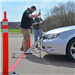 Two men checking a car at the Teen Driving Competition