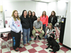 An officer, students, and canine after a presentation