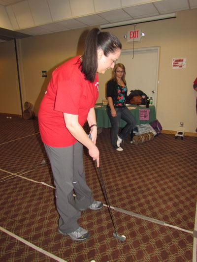 A person plays a game at the Workforce Olympics 2014