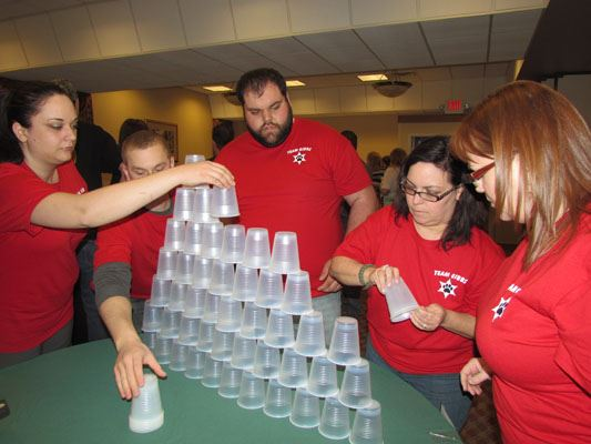 Peopel stack cups at the Workforce Olympics 2014